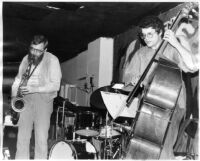 Charlie Haden and Lew Tabackin on stage, 1980 [descriptive]