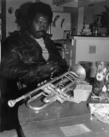 Harold Howard with trumpet, circa 1980 [descriptive]