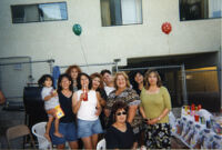 Nancy with friends and family at party