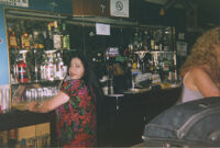 Woman on phone in bar
