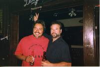 Guys posing drinking beer