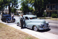 Frank standing by lowrider