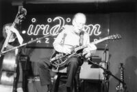 Les Paul and unidentified double bass player at the Iridium Jazz Club in New York City, circa 2002 [descriptive]