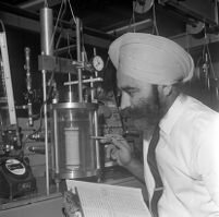 Awtar Singh examines soil sample from Mount Washington landslide, Los Angeles, 1969