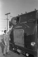 Wheel lodged into gasoline truck's windshield, California, 1969.