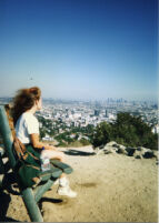 Nancy on bench looking at Los Angeles