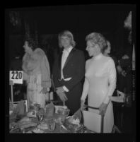 Norman B. Chandler with mother Marilyn Brant at Las Madrinas Ball, 1973.