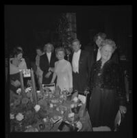 Otis Chandler (center) with wife Marilyn Brant (left) mother Dorothy Buffum Chandler and sons at the Las Madrinas Ball, 1973.