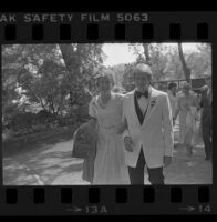 Norman B. Chandler escorts guest at wedding of brother Harry Brant, 1979.
