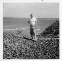 Soldier standing near beach