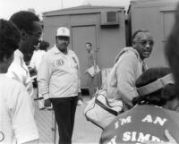 Andy Simpkins with Bill Cosby at the Playboy Jazz Festival in Los Angeles, 1983 [descriptive]