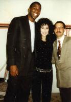 Magic Johnson, Cher, and unknown man