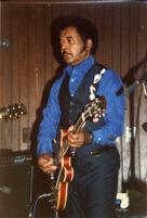 Jimmy Johnson playing guitar, 1987 [descriptive]