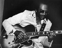Ray Crawford (aka H. Ray Crawford) playing guitar, 1980 [descriptive]
