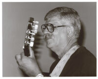 Dori Caymmi playing guitar, Los Angeles, August 1999 [descriptive]