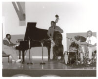 Cyrus Chestnut and two unidentified musicians performing, Los Angeles [descriptive]