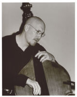 Scott Colley playing the double bass in Los Angeles [descriptive]