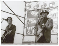 Bo Diddley and an unidentified guitarist performing at the Santa Monica Pier Twilight Dance Series, July 9, 1998 [descriptive]
