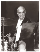 Chuck Flores playing the drums in Los Angeles [descriptive]