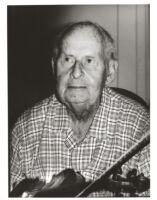 Stéphane Grappelli holding a violin, Los Angeles, August 1995 [descriptive]