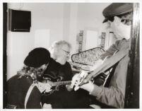 David Grisman plays the mandolin in Los Angeles, February 1997 [descriptive]