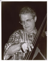 Charlie Haden playing double bass, Los Angeles [descriptive]