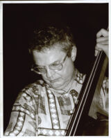 Charlie Haden playing the double bass, Los Angeles [descriptive]