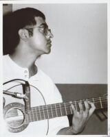 Fareed Haque playing guitar, Los Angeles [descriptive]