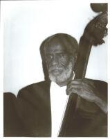 John Heard playing double bass in Los Angeles [descriptive]