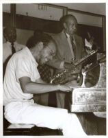 Harold Land playing saxophone and an unidentified man on piano, Los Angeles [descriptive]