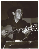 Mayuto playing guitar in Los Angeles, July 1996 [descriptive]