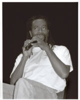 Bobby McFerrin seated with microphone, Los Angeles [descriptive]