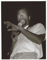 Bobby McFerrin holding a microphone, Los Angeles [descriptive]