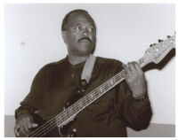 Charles Meeks playing the bass guitar in Los Angeles [descriptive]