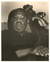 Rich Reid playing the double bass, Los Angeles [descriptive]
