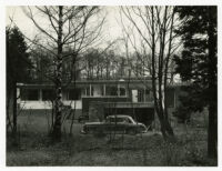 Rang House, view of exterior and car through surrounding trees, Germany, 1961