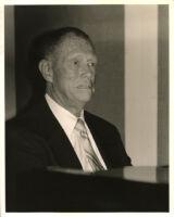 Paul Smith sitting at a piano, Los Angeles [descriptive]