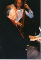 George Shearing playing piano and unidentified man playing double bass, Los Angeles, April 1997 [descriptive]