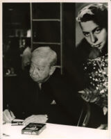 Mel Tormé signing autographs in Los Angeles, June 1996 [descriptive]