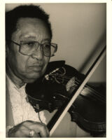 "Claude ""Fiddler"" Williams playing the violin in Los Angeles [descriptive]"