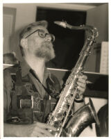 Lew Tabackin playing sax in Los Angeles [descriptive]