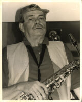 Phil Woods holding an alto saxophone, Los Angeles, July 1997 [descriptive]