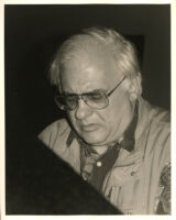 Paul Bley sitting at a piano, Los Angeles, February 1996 [descriptive]
