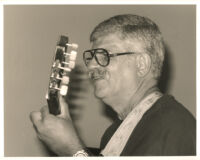 Dori Caymmi playing the guitar in Los Angeles, August 1999 [descriptive]