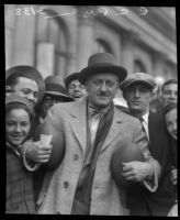 Famous sports agent and football promoter C.C. Pyle poses with celebrating crowd.