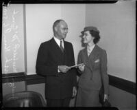 Actress Marsha Hunt receives a document from Judge Marshall McComb.