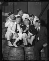 American Legion members pose, singing atop barrels, during the 1936 California state convention.