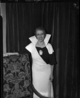 Evangelist Aimee Semple McPherson poses in evening dress.