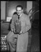 Snapshot of Guy Lombardo, holding his own camera.