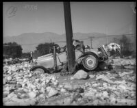 Wreckage of a car along a highway after flooding due to record rainfall, La Crescenta-Montrose, 1934